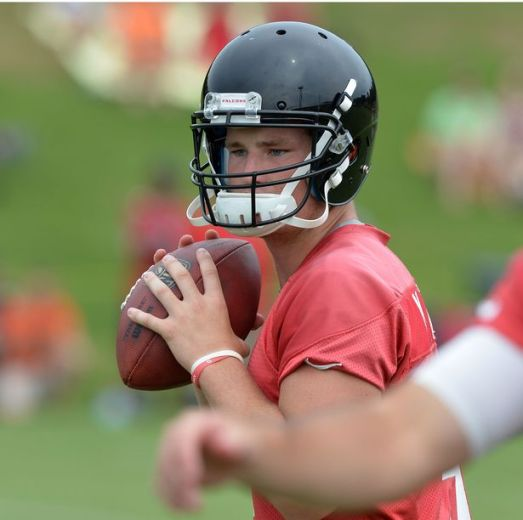 Falcons rookie QB Jeff Mathews looks to throw during the minicamp. Atlanta Falcons players workout during the second day of mini-camp at the team's facilities in Flowery Branch, Wednesday, June 18, 2014. (KENT D. JOHNSON/KDJOHNSON@AJC.COM)